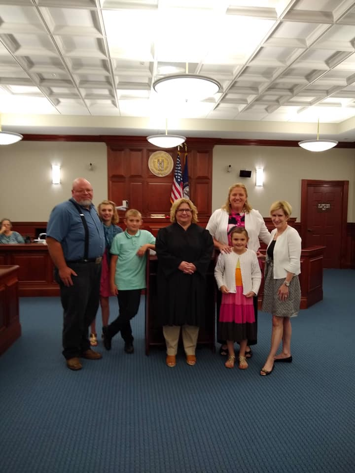 Judge Monica Meredith of Bullitt Family Court with family adoption